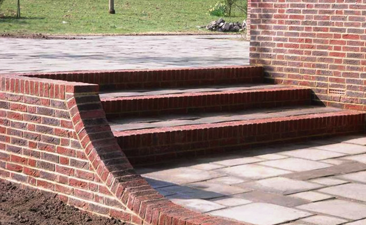 Brickwork steps and curved safety wall