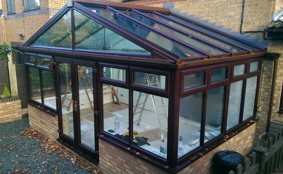Conservatory with half wall base