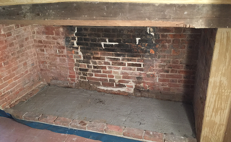 Inglenook fireplace during the repair process