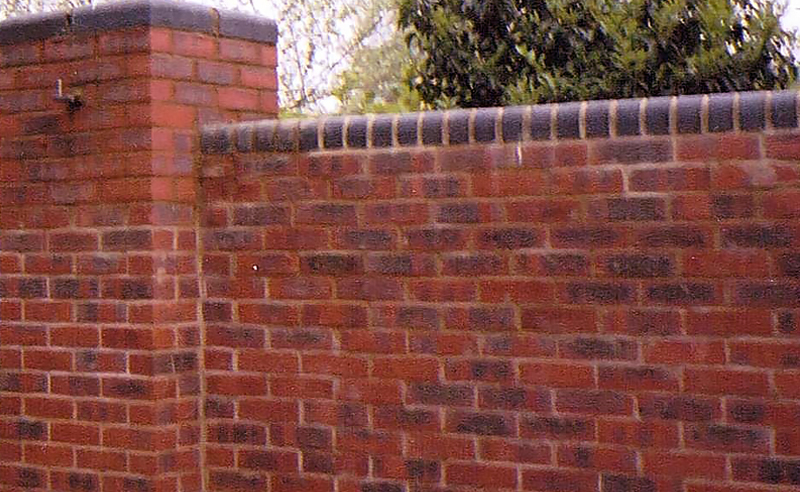 Boundary wall and gate post